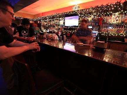 Eighteen Twenty Lounge view of bar with people